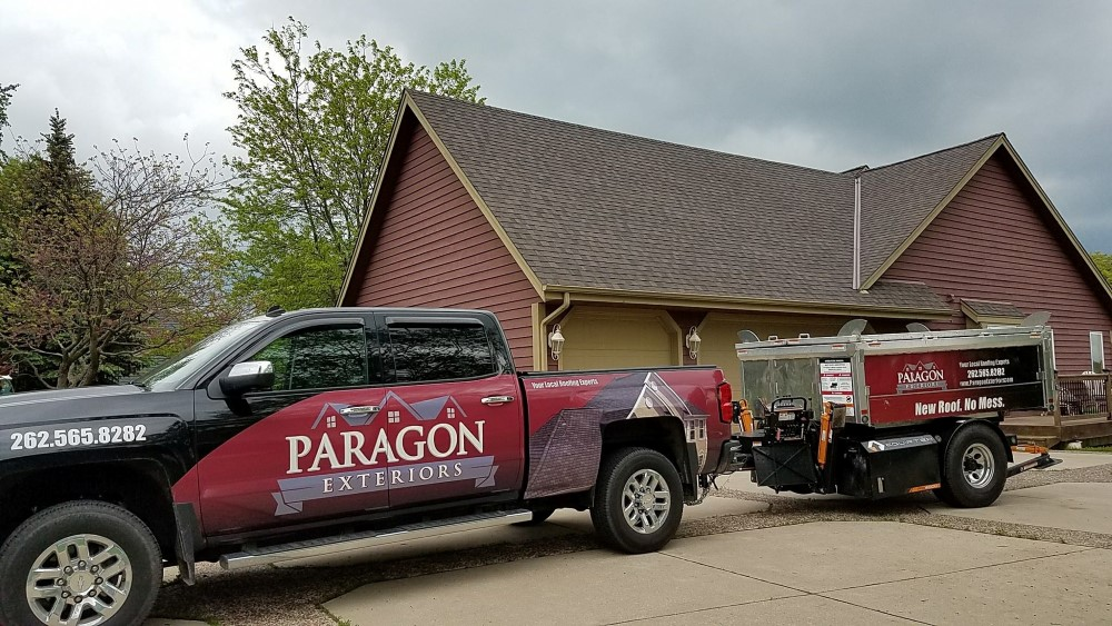 Paragon Exteriors LLC Truck and Trailer On-Site In Brookfield Wisconsin.