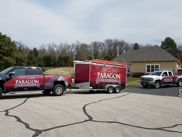 Paragon Exteriors LLC Trucks and Trailers On Hartland Wisconsin Job site.